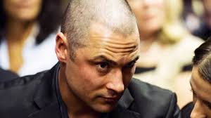 Carl Pistorius, brother of the famed Paralympian who allegedly beat and shot his girlfriend to death, is facing his own criminal charges of killing a woman. - Carl-Pistorius