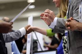 job search tag newshour corporate recruiters r gesture and shake hands as they talk job seekers at