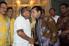 graft scandal rocks s establishment asia times golkar party leader setya novanto shakes hands chairman of the board of golkar party aburizal
