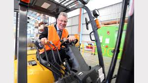 forklifts warehouses and a second chance the border mail minister for higher education and skills peter hall has a test run on the forklift