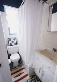 after far too many months with one of those little ikea signe rugs folded up into thirds to fit in the tiny gap between the wall and the tub see that