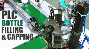 Automatic Bottle Filling & <b>Capping Machine</b> Using PLC - YouTube