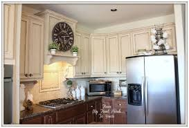 who paints kitchen cabinets