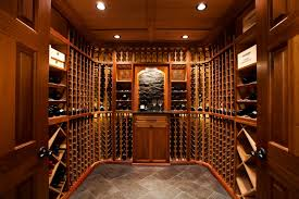 cool traditional wine cellar design using wooden furniture for shelving completed with concrete tile flooring in awesome wine cellar