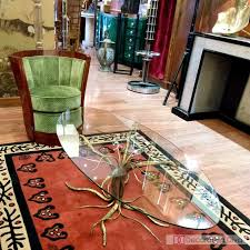 art deco green swivel chair brass branch stump base and glass table on top of antique deco wooden chair swivel