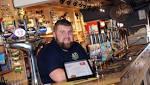 Cheers! Tavern and Lower Angel mark Good Beer Guide milestones