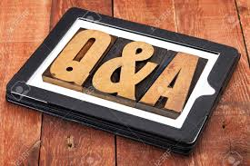 questions and answers q a in vintage letterpress wood type stock photo questions and answers q a in vintage letterpress wood type on a digital tablet against red barn wood