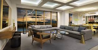 bathroom suite mandarin: delano suite living room multiple light arch lamp sectional grey sofa modern glass coffe table