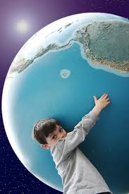 Photo of a young man holding an oversized globe