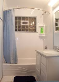 small bathroom clock:  tempered glass window and exquisite blue shower curtain idea plus sleek small bathroom remodel