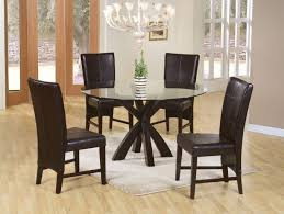 dining table parson chairs interior: glass top dining table with parson chair and chandelier