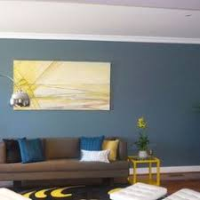working with blue walls seeing a lot of neutral combinations with blue walls brown furniture