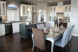 countertops dark wood kitchen islands table: another great exercise in contrast this kitchen features white cabinetry over dark wood flooring