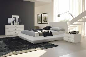 bedroom chic interior design of master bedroom with white cushioned platform bed plus grey wall also glossy white furniture set master bedroom design bedroom ideas white furniture
