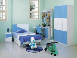 bedroom kid: kids bedroom furniture with white twin bed made of wood and steel legs also three doors blue cupboard with study desk sets made of wood