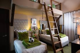 hgtv mid sized contemporary kids room idea for boys in atlanta with brown walls and carpet boys room dorm