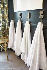 guest bathroom towels: abby m interiors one room challenge week  the reveal before the bathroom only had one towel bar that didnt work very well for two boys and guests
