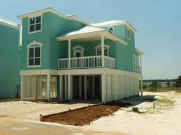 Oglethorpe Raised Beach Home Plan D    House Plans and MoreSunbelt Home Plan Front Photo   D    House Plans and More