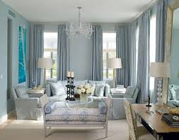 blue elegant living room design with blue silk drapes blue upholstered sofa blue chairs blue room white