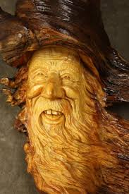 Image result for smiling face in carved wood