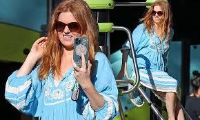 <b>Isla</b> Fisher looks <b>chic</b> in a blue bohemian <b>dress</b> as she climbs on a ...