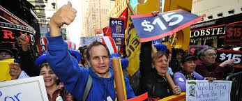 the difference between and minimum wage bigger than you photo protesters gather on 7th avenue between 42nd and 41st streets rallying over
