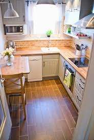 kitchen floor tiles small space: tiny kitchen makeover with painted backsplash and wood tile floors pudel design featured on