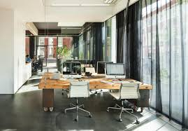 pduring work hours the desks balance on rolling cabinets to keep them agency office literally disappears hours