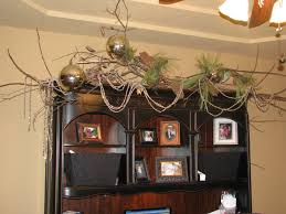 decoration ideas startling dry twig decoration with gold ball ornament above the office cupboard sweet office business office decorating themes home office christmas