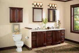 dark brown lacquer mahogany wood wall cabinet over the toilet attached on cream painted wall with brown bathroom furniture