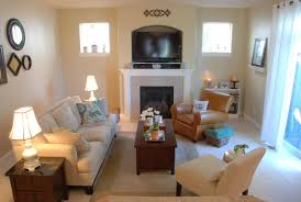living room desks furniture: awesome pottery barn style living room which is implemented with small fireplace next to light brown arm soft chair facing white sofa and twin bright desk