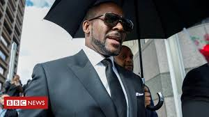 R. Kelly faces charges of prostitution involving a minor - BBC News