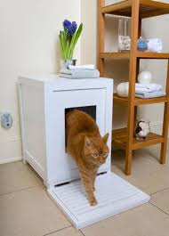small cat litter box furniture in white with square entry hole beside simple wooden shelves cat litter box covers furniture