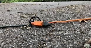 12 South residents extend <b>cords</b> across the <b>street</b> to help neighbors ...