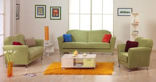 green black mesmerizing: pale green fabric sofa with colorful cushions combined with cream wooden rectangle table on the yellow
