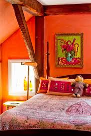 orange wall paint bedroom traditional