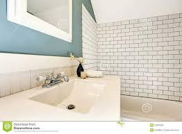 bathroom white tiles: aqua bathroom with white tile wall trim stock photography