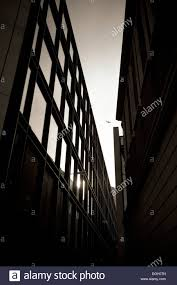 office define. stock photo two modern office buildings define a v in the sky through which an ariliner flies between o