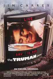 the truman show   wikipediathe truman show  film poster  on the side of the building is a large screen  showing a