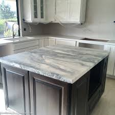 calacatta marble kitchen waterfall: honed marble island top kitchen remodel