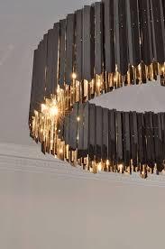 black chandelier lighting. nice golden light facet chandelier black nickel contemporary lighting project by tom kirk