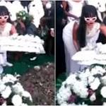 'Sleep well buddy': Devasted Rihanna lays wreath on murdered cousin's grave as he's laid to rest at funeral in Barbados