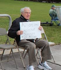 doctor arrested in allianz holocaust protest west boca news allianz protester