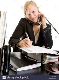 office assistant phoning office desk work business w manager stock photo office assistant phoning office desk work business w manager young businessw tradesw secretary clerk noticing noting