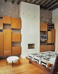 traditional modular bedroom furniture set installed on the wall with floor to ceiling fireplace as warmer bedroom modular furniture