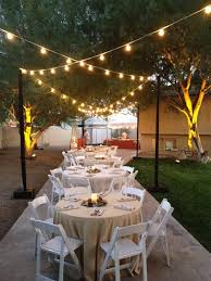 created an elegant backyard party with special bistro string lighting and amber tree up lighting backyard party lighting