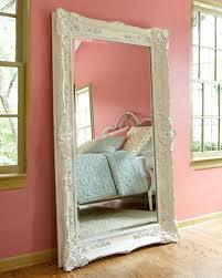 traditional bedroom long wooden framed mirror