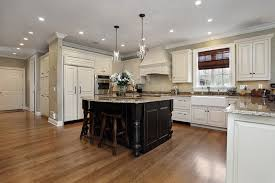 kitchen with white cabinets and black cabinet island with granite counter and glass pendant lighting cabinet and lighting
