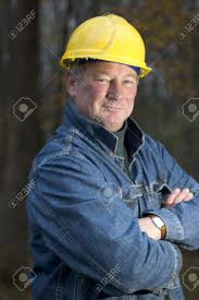 contractor handyman builder smiling confident happy on the job stock photo contractor handyman builder smiling confident happy on the job