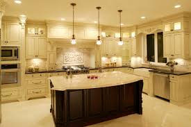 build kitchen island sink: luxurious kitchen awash in light marble tones dominated by large dark wood island with filigreed